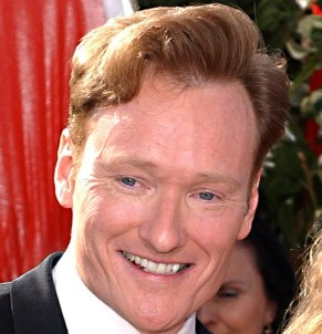 "**FILE** Conan O'Brien is shown in this Sept. 19, 2004, file photo in Los Angeles. O'Brien said he was looking forward to ""being on at a time when people can see me"" when he replaces Jay Leno as host of the ""Tonight"" show in five years. NBC announced last week that O'Brien, whose show airs at 12:35 a.m. Eastern, will move up an hour earlier when he takes over for Leno in 2009. (AP Photo/Tammie Arroyo, File)"
